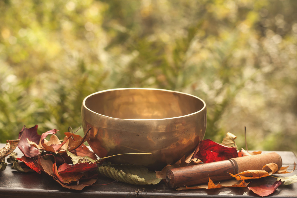 singing bowl made of seven metals surrounded of colorful autumn
