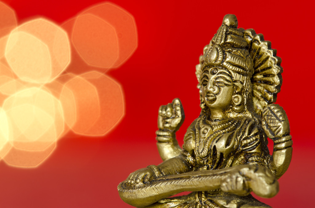 close up of a hindu deity statue on red background