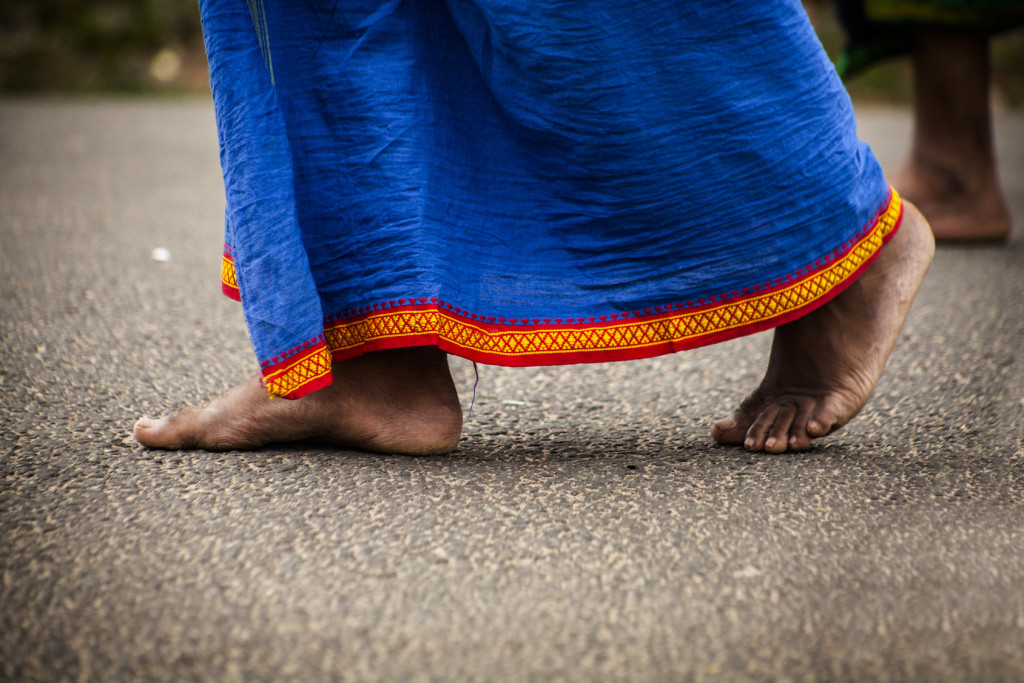 Feet of indian man in traditional clothes
