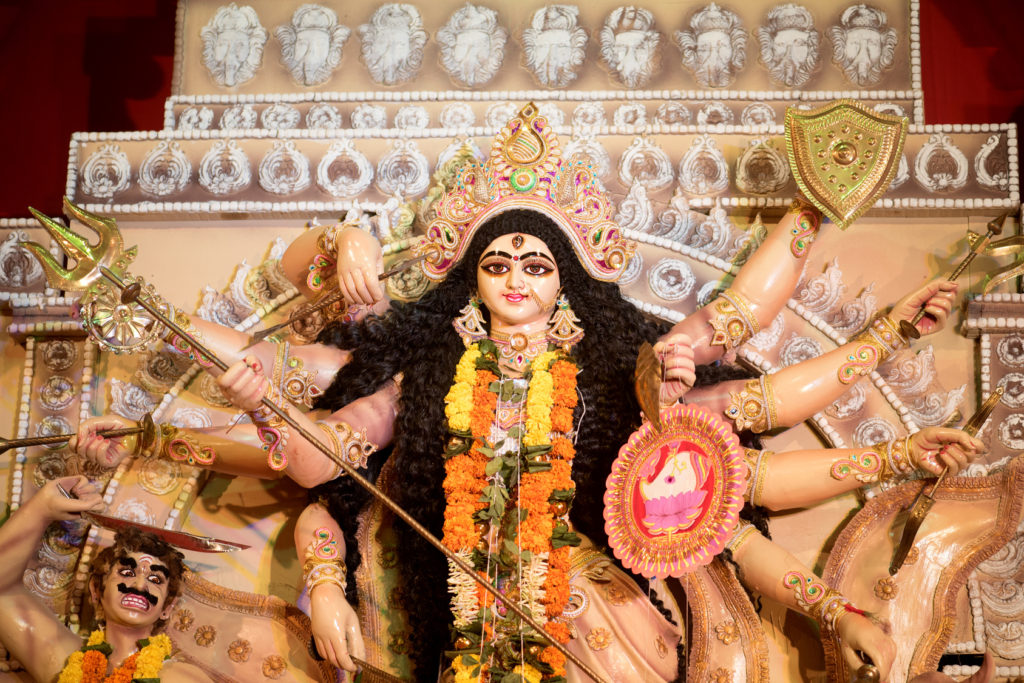 MUMBAI, INDIA - October 20, 2015: An idol of revered goddess Durga standing in the temporary temple in the city of Mumbai during Durga Puja festival celebration.